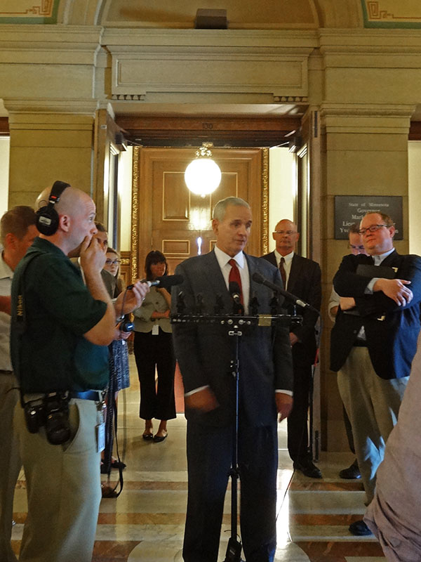 Governor Dayton speaks to reporters